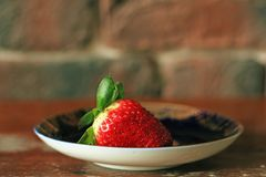 Strawberries on a saucer royalty free stock images
