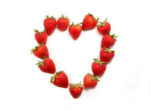 Strawberries shaped to form a heart on white Royalty Free Stock Image