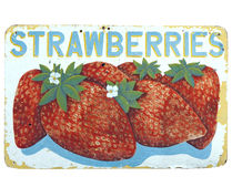 Strawberries Sign. Faded and weathered hand lettered and hand painted STRAWBERRIES sign. Isolated Royalty Free Stock Photos