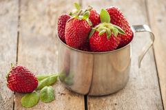 Strawberries in silver cup Stock Photos