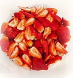 STRAWBERRIES. Sliced in a bowl Royalty Free Stock Image