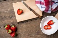 Strawberries sliced on chopping board. Fresh strawberries sliced on chopping board stock image