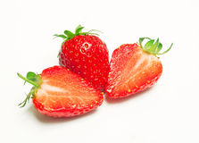 Strawberries. Sliced strawberries isolated fruit background Royalty Free Stock Image