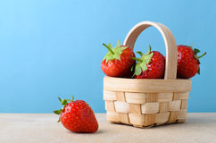 Strawberries in Small Basket with Blue Background Stock Photography