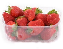 Strawberries in a small plastic cup Royalty Free Stock Photos