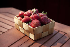 Strawberries in a small wooden basket Stock Photo