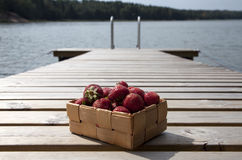 Strawberries in a small wooden basket Royalty Free Stock Photo