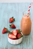 Strawberries with Smoothie in Glass Bottle Royalty Free Stock Images