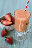 Strawberries with Smoothie in Glass Mug Close up Royalty Free Stock Photo
