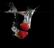 Strawberries splash Royalty Free Stock Photos
