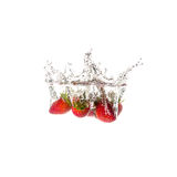 Strawberries splash on water, isolated Stock Images