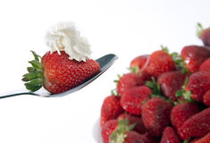 Strawberries and spoon. Strawberries and cream on white  background with bowl Stock Photos