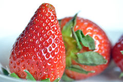 Strawberries, still life. Strawberries  cut and ready to eat Stock Images