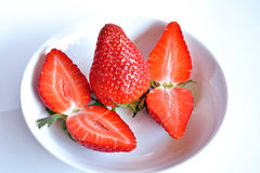 Strawberries, still life. Strawberries  cut and ready to eat Royalty Free Stock Images