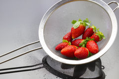 Strawberries in strainer Royalty Free Stock Images