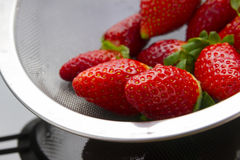 Strawberries in strainer Stock Photography
