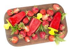 Strawberries, strawberry ice cream on a wooden board, strawberri Royalty Free Stock Photos