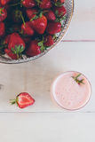 Strawberries and strawberry milk shake on a white vintage wooden Stock Photo