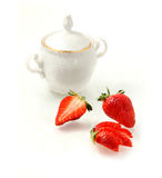 Strawberries  and sugar-bowl Royalty Free Stock Photo