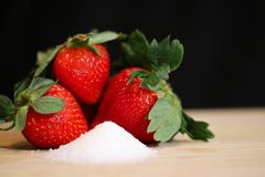 Strawberries and sugar Stock Photography