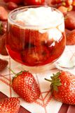 Strawberries in syrup and cream. Strawberries in syrup and sour cream. Sweet cold dessert Royalty Free Stock Images