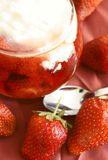 Strawberries in syrup and sour cream. Sweet cold dessert Royalty Free Stock Image