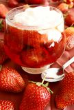 Strawberries in syrup and sour cream. Sweet cold dessert Royalty Free Stock Photography