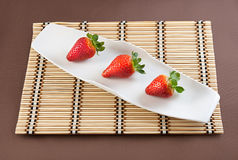 Strawberries on table mat. Strawberries with chocolate on table mat for Valentine's day or other love related situation Stock Photography