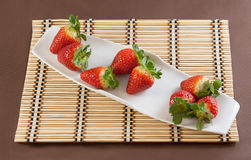 Strawberries on table mat. Strawberries with chocolate on table mat for Valentine's day or other love related situation Stock Images