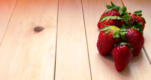 Strawberries in a table wood Royalty Free Stock Image