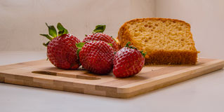 Strawberries in a table wood Stock Image