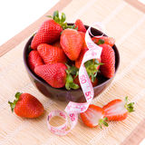 Strawberries and tailor tape Stock Photo