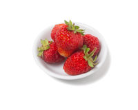 Strawberries with tails on a saucer Royalty Free Stock Images