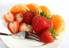 Strawberries and tangerines with fork Royalty Free Stock Photography