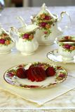 Strawberries and Tea. Tea Time. Fresh strawberries and tea on porcelain china dishes Stock Photography