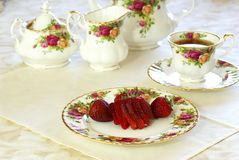 Strawberries and Tea. Tea Time. Fresh strawberries and tea on porcelain china dishes Royalty Free Stock Images
