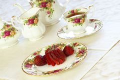 Strawberries and Tea. Tea Time. Fresh strawberries and tea on porcelain china dishes Stock Image