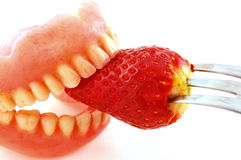 Strawberries in the teeth Stock Photo