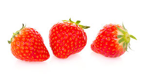 Strawberries. Three strawberries isolated on white a background Royalty Free Stock Photography