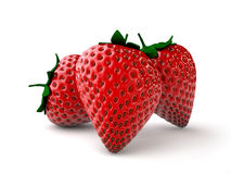 Strawberries. Three ripe strawberries on a white background Royalty Free Stock Image