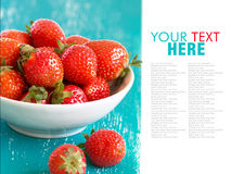 Strawberries on turquoise wooden table Stock Photography
