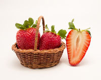 Strawberries and two in basket Royalty Free Stock Photos