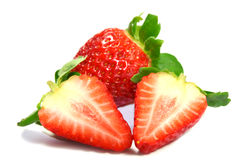 Strawberries. Two strawberries one plus two halves , red juicy berries summer flavor stock photos