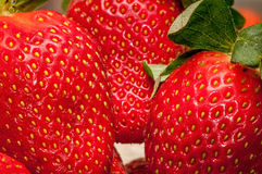 Strawberries up close. Macro view of some strawberries in high-resolution, featuring detailed structures Royalty Free Stock Photo
