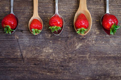 Strawberries on vintage spoons Stock Photos