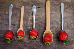 Strawberries on vintage spoons Royalty Free Stock Image