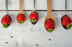 Strawberries on vintage spoons Royalty Free Stock Photos
