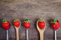 Strawberries on vintage spoons Royalty Free Stock Photography