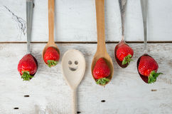 Strawberries on vintage spoons Royalty Free Stock Photo