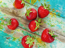 Strawberries on vintage wooden blue background Stock Images
